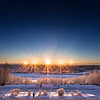 "The sun rises and sets above the Alaska Range south of Fairbanks in this composite image taken from the roof of the Reichardt Building on Dec. 21, the day of the winter solstice.  <div class=""ss-paypal-button"">Filename: CAM-17-5588-286.jpg</div><div class=""ss-paypal-button-end""></div>"