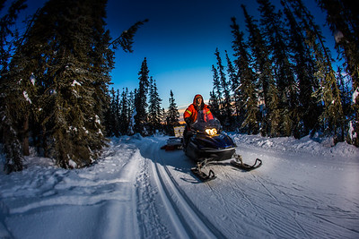 Ski trails manager Jason Garron grooms the skate ski track on the UAF trails early on a cold February morning.  Filename: CAM-16-4818-66.jpg