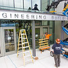 "A crew from Hoffer Glass installs panels on the entry way to the new engineering building on the Fairbanks campus in August 2015.  <div class=""ss-paypal-button"">Filename: CAM-15-4634-024.jpg</div><div class=""ss-paypal-button-end""></div>"