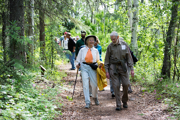 """Attendees of the Les Viereck Nature Trail dedication walk the Les Viereck Nature Trail after the ceremony.  <div class=""""ss-paypal-button"""">Filename: CAM-12-3435-66.jpg</div><div class=""""ss-paypal-button-end"""" style=""""""""></div>"""