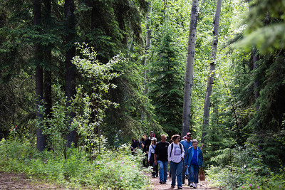 Attendees of the Les Viereck Nature Trail dedication walk the Les Viereck Nature Trail after the ceremony.  Filename: CAM-12-3435-71.jpg