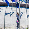"A student walks through the circle of flags in Cornerstone Plaza on the Fairbanks campus.  <div class=""ss-paypal-button"">Filename: CAM-12-3541-37.jpg</div><div class=""ss-paypal-button-end"" style=""""></div>"