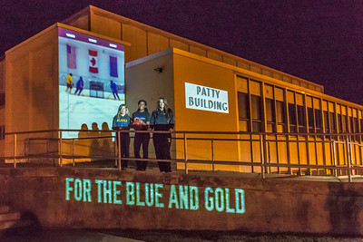 Members of the Nanooks women's basketball team pose in front of the Patty Center Student during a late night promotional multi-media production introducing the Nanook Nation theme.  Filename: CAM-13-3925-168.jpg