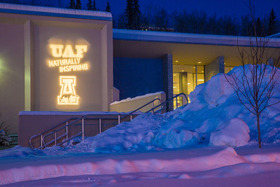 UAF's Naturally Inspiring hashtag adorns the front wall of the Patty Center on the Fairbanks campus.  Filename: CAM-13-3702-5.jpg