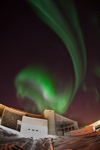 The aurora borealis dances across the night sky above the Arctic Health Research Building on UAF's West Ridge.  Filename: CAM-12-3324-12.jpg