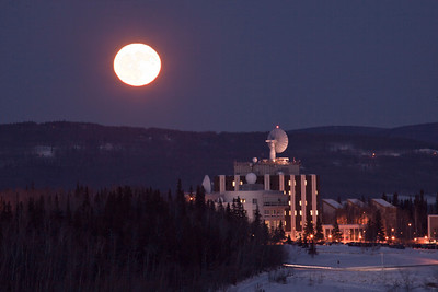 A full moon rises over the hill behind UAF's West Ridge on a cold January afternoon.  Filename: CAM-11-2965-61.jpg