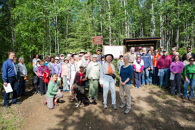 Teri Viereck and Sherry Modrow pose for a photograph with the dedication party of the Les Viereck Nature Trail after the ceremony.  Filename: CAM-12-3435-53.jpg
