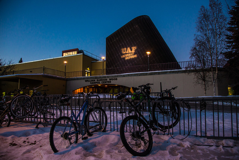 """UAF's """"Naturally Inspiring"""" branding tagline is projected onto the exterior of Wood Center.  <div class=""""ss-paypal-button"""">Filename: CAM-12-3657-2.jpg</div><div class=""""ss-paypal-button-end"""" style=""""""""></div>"""