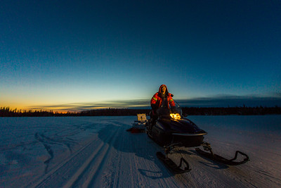 Ski trails manager Jason Garron grooms the skate ski track on the UAF trails early on a cold February morning.  Filename: CAM-16-4818-27.jpg