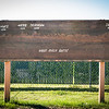"""A wooden explanatory sign of the Alaska Range is located in front of the Reichardt building on campus.  <div class=""""ss-paypal-button"""">Filename: CAM-13-3894-2.jpg</div><div class=""""ss-paypal-button-end"""" style=""""""""></div>"""