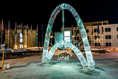 The traditional ice arch stands lit up in Cornerstone Plaza on the UAF campus in February 2016. The arch, designed and built by students with UAF's College of Engineering and Mines, is a tradition that dates back almost 75 years.  Filename: CAM-16-4817-11.jpg