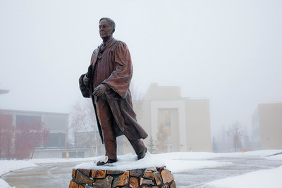 The statue of Charles Bunnell stands alone after a freak early winter rain storm closed campus due to icy roads.  Filename: CAM-10-2943-02.jpg