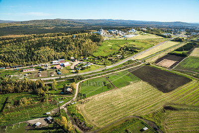 An aerial view of UAF looking east toward Fairbanks at about 11:15 a.m. on Sept. 10, 2016. The experiment farm operated by the School of Natural Resources and Extension is featured in the lower left of this photo.  Filename: CAM-16-4992-008.jpg