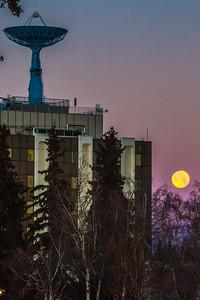 A full November moon sets behind the Elvey Building on the Fairbanks campus.  Filename: CAM-14-4376-22.jpg