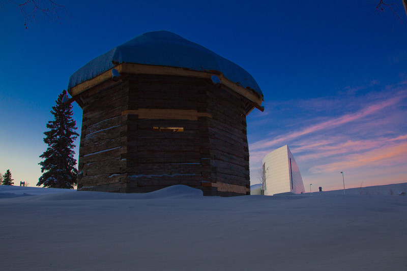 """The 19th century Russian blockhouse stands in stark contrast to the modern University of Alaska Museum of the North on the Fairbanks campus.  <div class=""""ss-paypal-button"""">Filename: CAM-12-3275-23.jpg</div><div class=""""ss-paypal-button-end"""" style=""""""""></div>"""