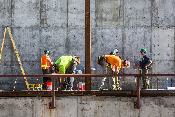"""Crews work on the Wood Center addition project on an August afternoon.  <div class=""""ss-paypal-button"""">Filename: CAM-13-3910-08.jpg</div><div class=""""ss-paypal-button-end"""" style=""""""""></div>"""