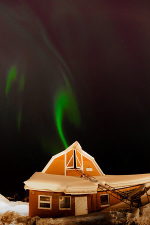 The aurora borealis dances across the night sky above the barn at  UAF's Agricultural and Forestry Experiment Station on the Fairbanks campus.  Filename: CAM-12-3324-49.jpg