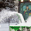 """Paul Dick, an equipment operator for Facilities Services, blows snow from a campus sidewalk after a November dusting.  <div class=""""ss-paypal-button"""">Filename: CAM-11-3213-15.jpg</div><div class=""""ss-paypal-button-end"""" style=""""""""></div>"""