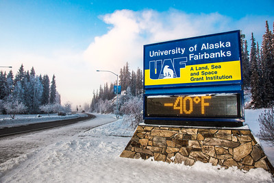 The time and temperature sign on Alumni Drive welcomes motorists and pedestrians to campus on a cold December morning.  Filename: CAM-12-3670-2.jpg