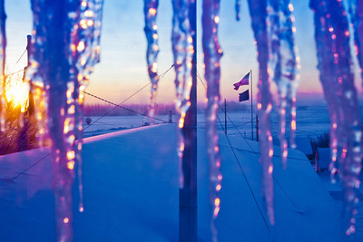 Icicles hang from the roof of one of the buildings at the Fairbanks Experiment Farm on a cold morning in January.  Filename: CAM-12-3257-09.jpg