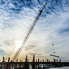 "A 220-foot crane lifts steel beems into position as workers complete the superstructure for the third floor of the new engineering facility in April 2014.  <div class=""ss-paypal-button"">Filename: CAM-14-4131-64.jpg</div><div class=""ss-paypal-button-end""></div>"