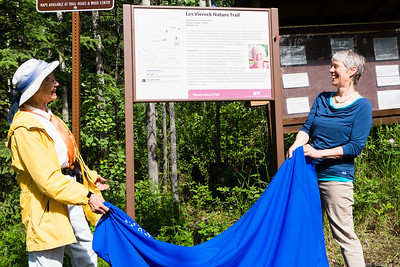 Teri Viereck, left, and Sherry Modrow, unveil the Les Viereck Nature Trail marker during the dedication ceremony of the trail.  Filename: CAM-12-3435-51.jpg