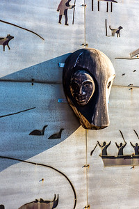 A metal mural adorns the side of a building at UAF's Northwest Campus in Nome.  Filename: CAM-16-4865-099.jpg
