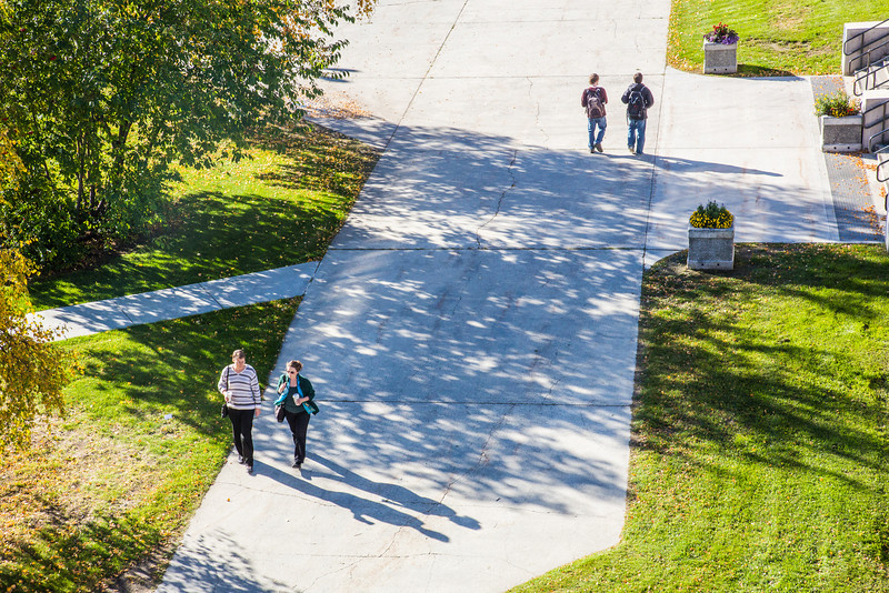 """Students and staff walk between buildings on a nice fall afternoon on the Fairbanks campus.  <div class=""""ss-paypal-button"""">Filename: CAM-12-3541-80.jpg</div><div class=""""ss-paypal-button-end"""" style=""""""""></div>"""