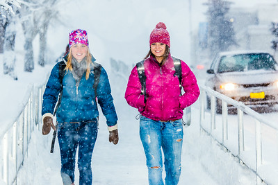 Students make their way around the Fairbanks campus through some freshly fallen snow on the first day of classes in the Spring 2014 semester.  Filename: CAM-14-4038-51.jpg