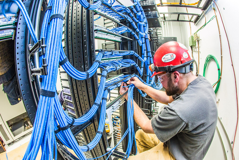 "An IT network specialist works on the communications infrastructure in the Murie Building a couple of months before it opens on UAF's West Ridge.  <div class=""ss-paypal-button"">Filename: CAM-13-3789-65.jpg</div><div class=""ss-paypal-button-end"" style=""""></div>"
