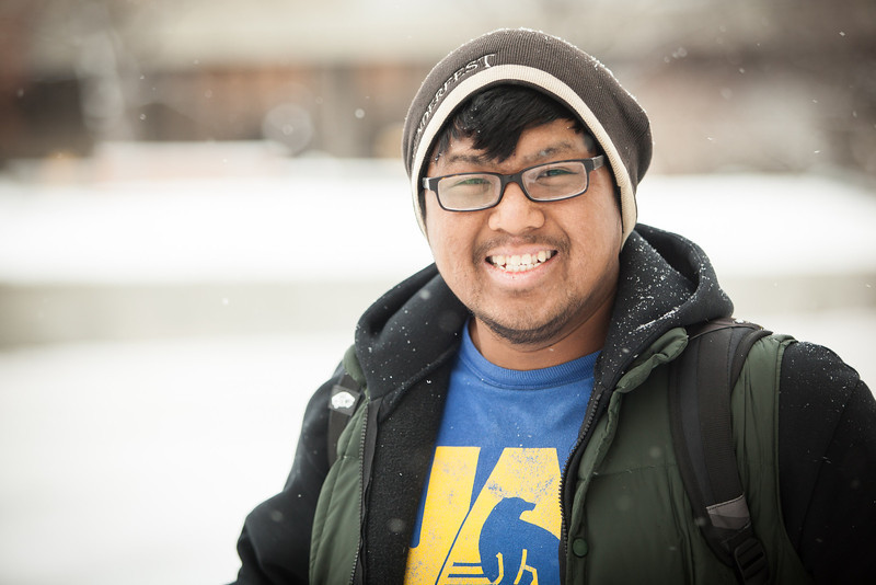 "JR Rosales pauses for a photograph in front of the Gruening building at the first snowfall of the semester in mid-October 2012.  <div class=""ss-paypal-button"">Filename: CAM-12-3589-54.jpg</div><div class=""ss-paypal-button-end"" style=""""></div>"