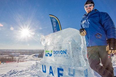 Mark Oldmixon, director of UAF's Department of Recreation, Adventure and Wellness (DRAW) rests on an ice carving near the top of the Hurlbert Nanook Terrain Park on a bluebird February day on the Fairbanks campus.  Filename: CAM-14-4088-3.jpg