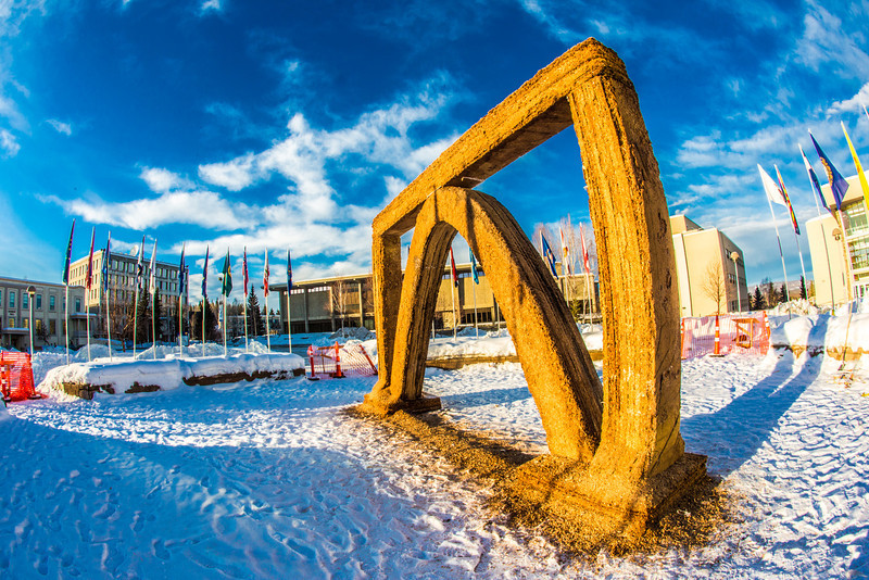 """The 2013 ice arch, designed and built on the Fairbanks campus each spring by engineering students, was constructed of pykrete - a combination of water and sawdust.  <div class=""""ss-paypal-button"""">Filename: CAM-13-3756-36.jpg</div><div class=""""ss-paypal-button-end"""" style=""""""""></div>"""
