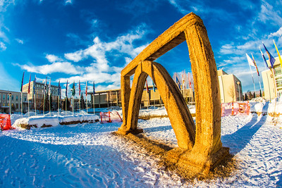 The 2013 ice arch, designed and built on the Fairbanks campus each spring by engineering students, was constructed of pykrete - a combination of water and sawdust.  Filename: CAM-13-3756-36.jpg
