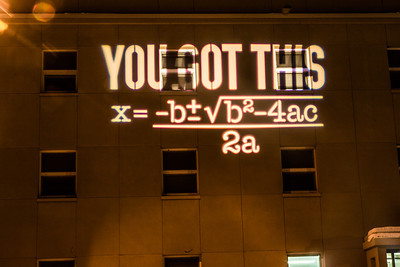 An encouraging equation is projected onto the Chapman Building during finals week.  Filename: CAM-13-4020-13.jpg