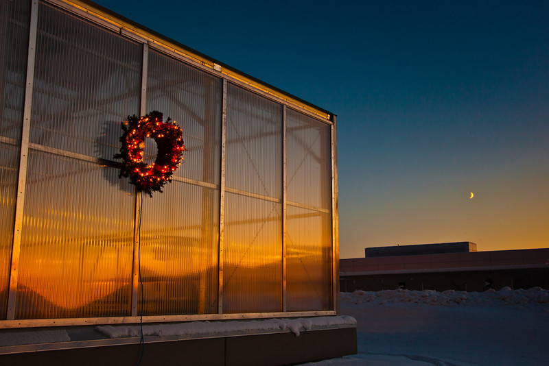 """A holiday wreath adorns the new School of Natural Resources and Agriculural Sciences greenhouse on UAF's West Ridge.  <div class=""""ss-paypal-button"""">Filename: CAM-11-3236-08.jpg</div><div class=""""ss-paypal-button-end"""" style=""""""""></div>"""