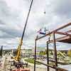 "Iron workers with Davis Constructors prepare to place the final steel beam into position in UAF's new engineering facility this afternoon while a crowd of university, legislative and business leaders look on. The final piece of steel is topped with Alaska and U.S. flags and, following an ancient  Scandinavian tradition, a small tree.  <div class=""ss-paypal-button"">Filename: CAM-14-4199-106.jpg</div><div class=""ss-paypal-button-end""></div>"