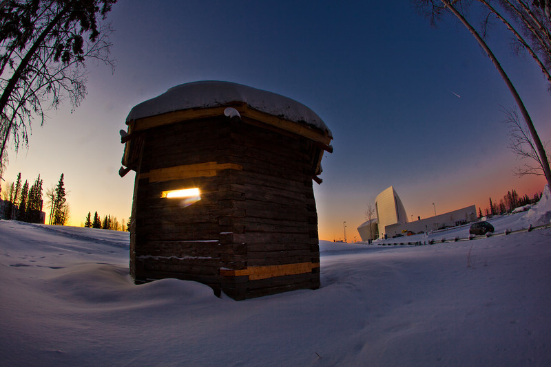 "The 1841 Russian blockhouse stands at first light on its new foundation near the University of Alaska Museum of the North. It was the first structure built by the Russian-American Company at Kolmakovsky Redoubt near Aniak. It is one of the oldest Russian-era structures in Alaska. In 1929, the blockhouse was disassembled and moved to Fairbanks where last summer a preservation team completed work on reattaching an updated roof outfitted with tundra sod and tamarack poles.  <div class=""ss-paypal-button"">Filename: CAM-12-3277-44.jpg</div><div class=""ss-paypal-button-end"" style=""""></div>"