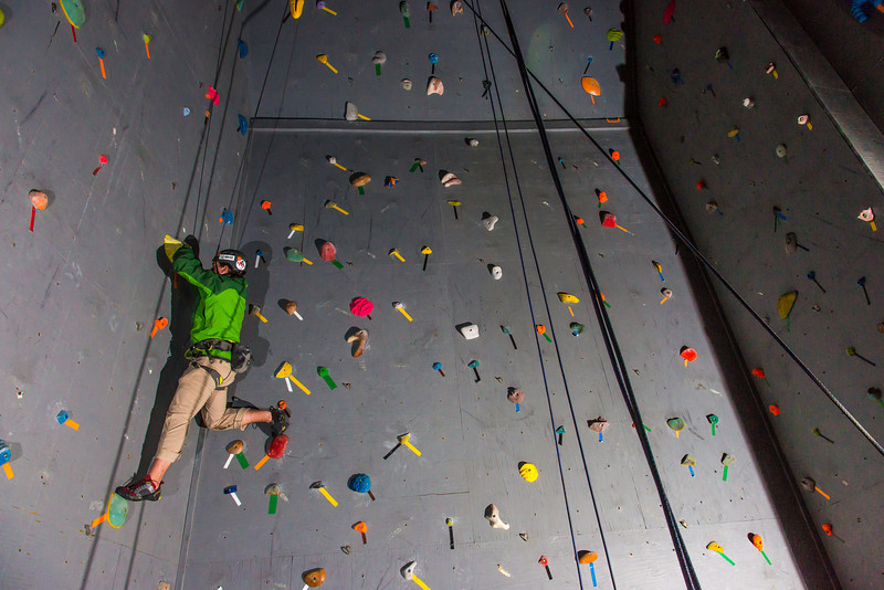 "A climber chooses his route during an evening event on UAF's climbing wall.  <div class=""ss-paypal-button"">Filename: CAM-13-3925-74.jpg</div><div class=""ss-paypal-button-end"" style=""""></div>"