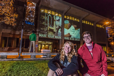 Undergraduates Teal Rogers and Jimmy Donohue pose during a late night promotional video shoot  by the Rasmuson Library.  Filename: CAM-13-3925-198.jpg