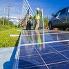 "Students in a class on solar photovoltaic design and installation prepare to mount solar panels along the road near the Cold Climate Housing Research Center  near the Fairbanks campus. The class is offered through UAF's Community and Technical College.  <div class=""ss-paypal-button"">Filename: CAM-12-3467-14.jpg</div><div class=""ss-paypal-button-end"" style=""""></div>"