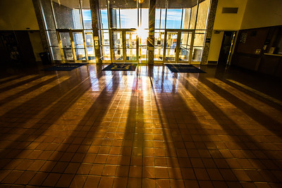 Intense shadows are seen in the lobby of the Patty Center at mid-day in early January.  Filename: CAM-13-3688 -7.jpg