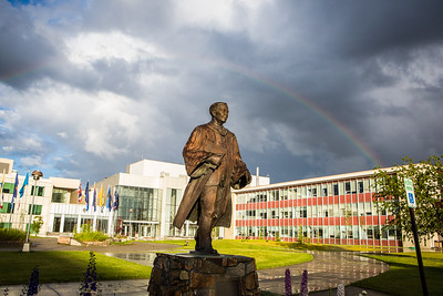 A rainbow appears over the Fairbanks campus during an evening shower at the start of the Fourth of July weekend.  Filename: CAM-16-4931-7.jpg