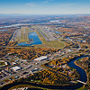 """An aerial view of Fairbanks looking south toward the confluence of the Chena and Tanana Rivers with the airport on the left and Mt. McKinley on the horizon.  <div class=""""ss-paypal-button"""">Filename: CAM-10-2870-297.jpg</div><div class=""""ss-paypal-button-end"""" style=""""""""></div>"""