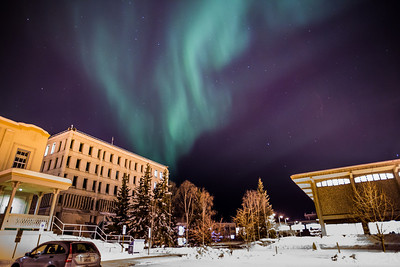 The aurora borealis floats above the Gruening Building and the rest of the Fairbanks campus.  Filename: CAM-13-3724-34.jpg