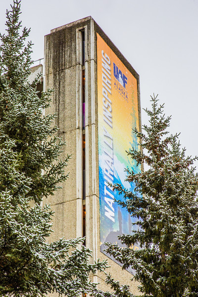 "A 40-foot banner hangs from the top of the Gruening Building fire escape to help promote UAF's brand.  <div class=""ss-paypal-button"">Filename: CAM-13-3944-35.jpg</div><div class=""ss-paypal-button-end"" style=""""></div>"