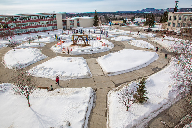 "The tradtional ice arch, designed and built by students in UAF's College of Engineering and Mines, stands each spring in Cornerstone Plaza on the Fairbanks campus.  <div class=""ss-paypal-button"">Filename: CAM-13-3776-19.jpg</div><div class=""ss-paypal-button-end"" style=""""></div>"
