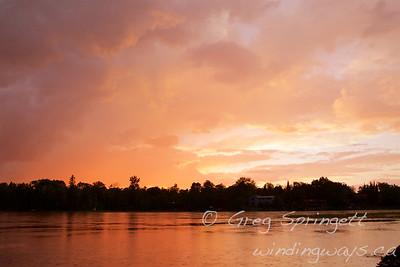 Sunset cottage dock muskoka chairs rain storm