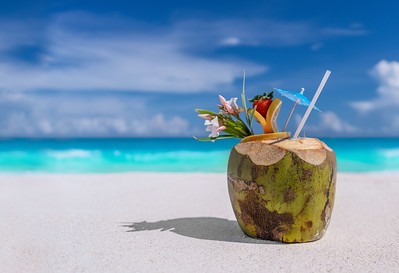 Coconut drink on a sandy beach
