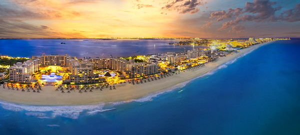 Cancun beach with orange sunset